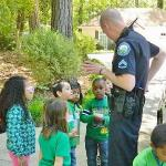 Officer Frommer talks with kids